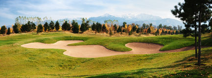 Panorama of golf course. In the autumn on against mountains Royalty Free Stock Photos