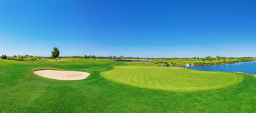 Panorama golf course lush grass. On the lake. royalty free stock photos