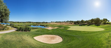 Panorama of a golf course sand trap. Royalty Free Stock Photography
