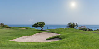 Panorama of a golf course on a sea background. Royalty Free Stock Photos