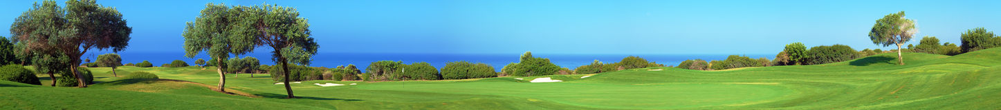 Panorama of Golf field, sea and olives. Wide panorama of golf field with sea and olive trees,  Paphos, Cyprus Royalty Free Stock Images