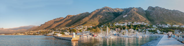 Panorama of Gordons Bay harbor and Hottentots-Holland Mountains Stock Photos