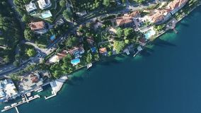 Panorama of the gorgeous Lake Garda surrounded by mountains, Italy. video shooting with drone.  stock footage