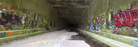 Panorama of grafitti in abandoned tunnel Stock Photography