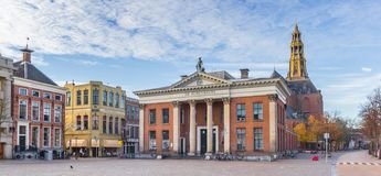 Panorama of the grain exchange building and church tower at the fish market square in Groningen. Netherlands royalty free stock photography