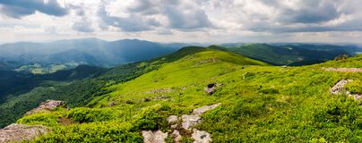 Panorama of great Carpathian water dividing ridge. Beautiful summer landscape view of Lviv and TransCarpathia regions of Ukraine from mountain Pikui royalty free stock images