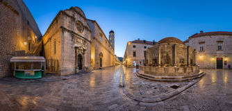 Panorama of Great Onofrio Fountain and Holy Saviour Church in th. DUBROVNIK, CROATIA - JULY 2, 2014: Panorama of Great Onofrio Fountain and Holy Saviour Church Royalty Free Stock Photos