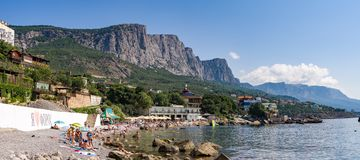 Panorama of the Green beach in the Central part of the village of foros with vacationers. Panorama of the Green beach in the Central part of the village of foros royalty free stock image