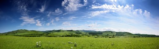 Panorama in green hills Stock Photography