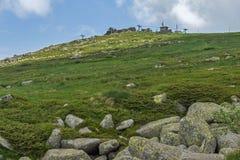 Panorama with green hills of Vitosha Mountain near Cherni Vrah Peak, Sofia City Region, Bulgaria Royalty Free Stock Image