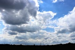 Panorama of grey clouds and industrial skyline. Panorama of industrial skyline with grey clouds overhead stock photography