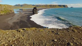 Panorama from ground to landscape with ocean waves and rocks on a southern coastline of Iceland. Panorama from ground to amazing landscape with ocean waves and stock video