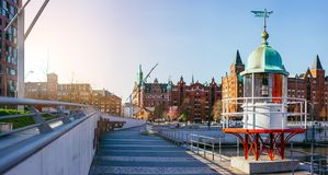 Panorama of Hafencity with old beacon lighthouse and red brick building in background, Speicherstadt in Hamburg.  Stock Photos