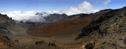 Panorama of The Haleakala Crater, Hawaii. At 10,000 feet, on the edge of a cliff, this is a view of a volcano crater within the Haleakala National Park, on Maui Royalty Free Stock Photos