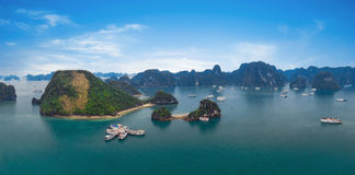 Panorama of Halong Bay Vietnam. Panoramic view of Ha Long. Islands, tourist junks, rock mountains and tropical sea water of famous landmark in Asia royalty free stock photo