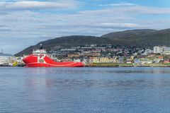 Panorama of Hammerfest and large red ship on the coast of the No. Panorama of Hammerfest and large red ship on the coast of Norwegian Sea Royalty Free Stock Photo