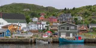 Petty Harbour in Newfoundland. Panorama of the harbor and colorful historic fishing village in Petty Harbour, Newfoundland and Labrador royalty free stock image