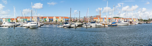 Panorama harbour Hellevoetsluis, Netherlands. Houses and yachts in the harbour of Hellevoetsluis, Netherlands stock image