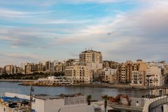 The panorama of harbour on St Pauls Bay, Mallta. The panorama of harbour on St Paul`s Bay with fishing boats and tourist ships, Bugibba, Malta royalty free stock image
