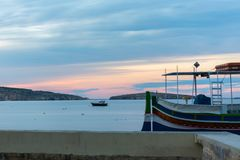 The panorama of harbour on St Pauls Bay, Mallta. The panorama of harbour on St Paul`s Bay with fishing boats and tourist ships, Bugibba, Malta stock photography