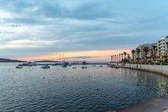 The panorama of harbour on St Pauls Bay, Mallta. The panorama of harbour on St Paul`s Bay with fishing boats and tourist ships, Bugibba, Malta stock photo