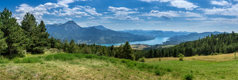 Panorama of the Hautes Alpes. Landscape panorama: awesome view over the lake Serre Poncon in the southern Alpes of France royalty free stock image