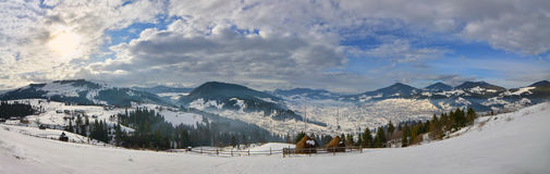 Panorama -haystack on the top of snow mountain and cloudy blue s Stock Photos