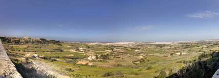 Panorama HDR photo of Malta landscape from the top of the historic city Mdina on sunny summer day.  Stock Photo
