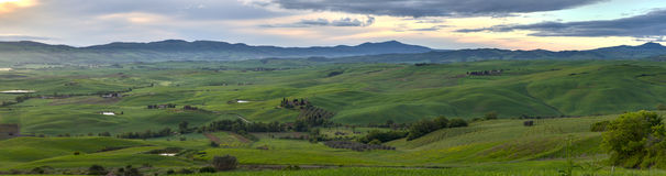 Panorama. HDR. View of the Orcia river valley. Early morning, sunrise, fog Stock Photos