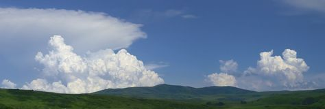 Panorama of Heaven. Blue cloudy sky panorama (3 horizontal shots Stock Photo