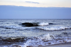 Panorama is the heavy wave and wind at coast in evening twilight Stock Photos