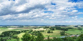 Panorama from a high altitude to a valley with fields and windmills. Hof, Bavaria, Germany. Panorama from a high altitude to a valley with fields and windmills stock image