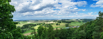 Panorama from a high altitude to a valley with fields and windmills. Hof, Bavaria, Germany. Panorama from a high altitude to a valley with fields and windmills royalty free stock photography