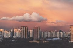 Panorama of high building town on sunset with colorful sky. Sunset Stock Photography