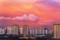 Panorama of high building town on sunset with colorful sky. Sunset Stock Photo