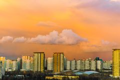 Panorama of high building town on sunset with colorful sky. Sunset Stock Photos