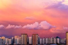 Panorama of high building town on sunset with colorful sky. Urban sunset Royalty Free Stock Image