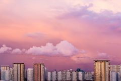 Panorama of high building town on sunset with colorful sky. Sunset Royalty Free Stock Photography