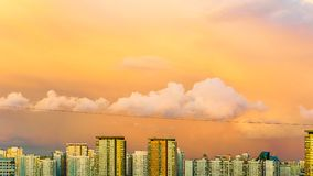 Panorama of high building town on sunset with colorful sky. Sunset Stock Images
