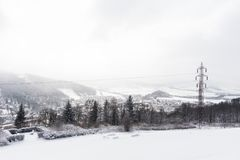 Panorama of high mountain peaks. Alpine mountains in winter. Panoramic view of snowy mountains. Panorama of high mountain peaks. Alpine mountains in winter Stock Photography