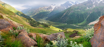 Panorama of the high mountains. And green meadow Royalty Free Stock Image