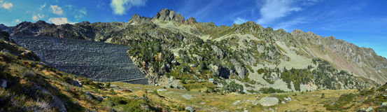Panorama of the High Pyrenees with a dam Stock Photography