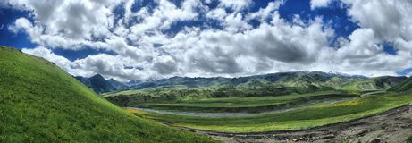 Panorama of high sky with clouds in mountains Royalty Free Stock Photography