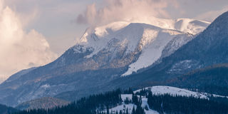 Panorama of high snowy mountains Royalty Free Stock Images
