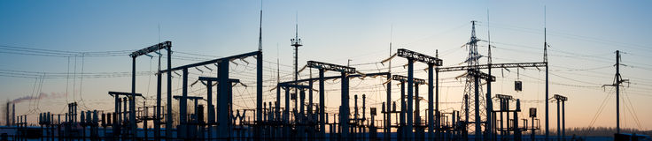 Panorama of high-voltage substation. Silhouette of high-voltage substation at sunset Royalty Free Stock Photo