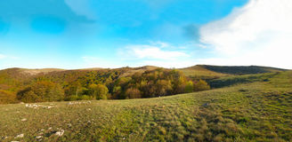 Panorama. Hills with cloudscape Stock Image