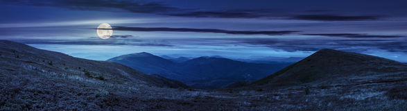 Panorama of hillside with stones in high mountains at night Stock Photos