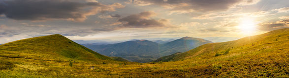 Panorama of hillside with stones in high mountains at sunset Stock Photography