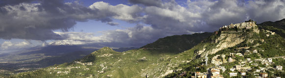 Panorama of the hilltop village Castelmola and the Etna Royalty Free Stock Photos