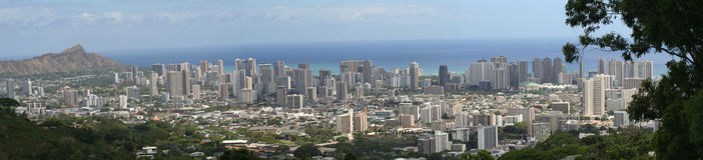 Panorama of Honolulu/Waikiki. A panorama of honolulu, hawaii. it includes Diamond head, and a few trees Royalty Free Stock Photography
